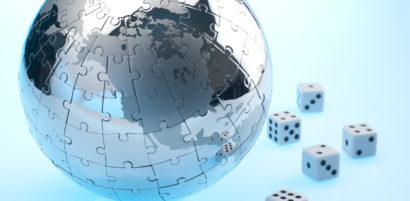 Global risk concept with dice and globe showing north America